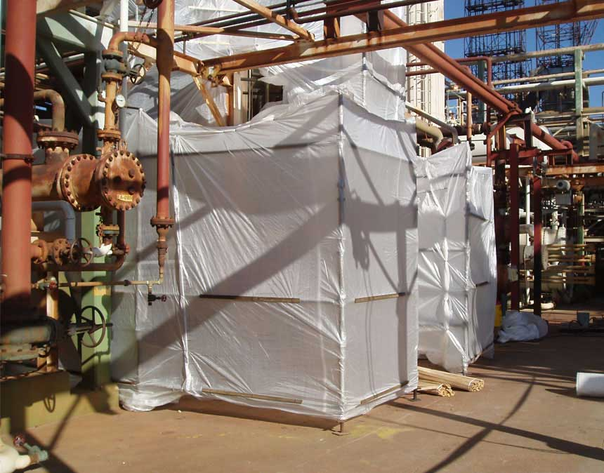 A photo of iSi Industrial Services' asbestos abatement project at an oil refinery.