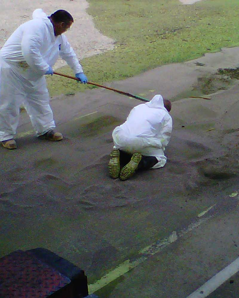 iSi environmental technicians clean up a hazardous materials spill at a manufacturing facility.