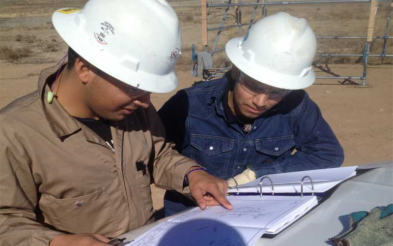 Photo of iSi Industrial Services team members conducting asbestos project management.