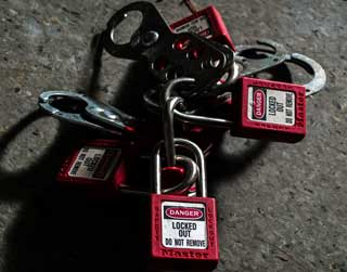A photo of lockout/tagout safety equipment compliant with OSHA regulations and written programs.